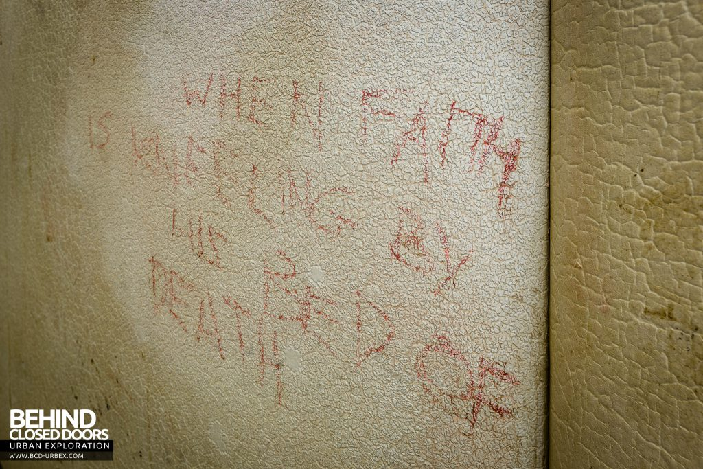 "Haslar Padded Cell - Writing on the wall reads ""When faith is kneeling by his bed of death"""