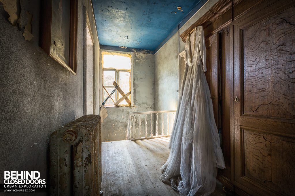 Manoir DP, Belgium - Wedding dress hanging on wardrobe