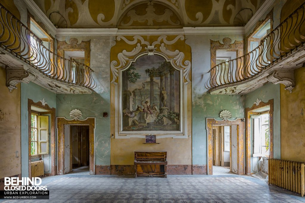 Villa Sbertolli, Italy - The main grand room with a piano and paintings