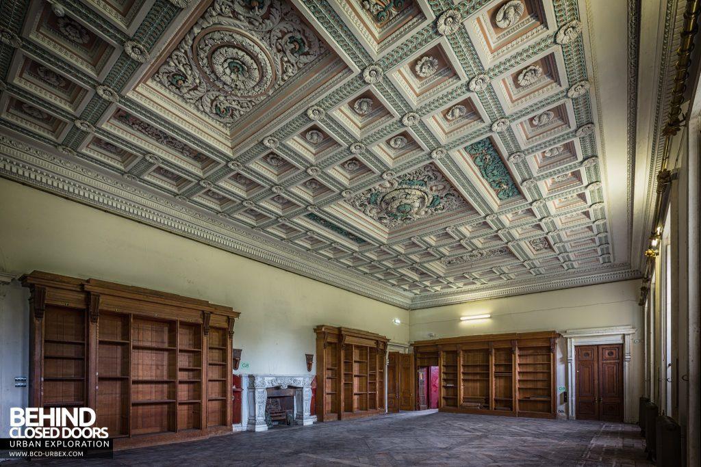 Tottenham House, Severnake - Bookshelves line a huge room with ornate plaster ceiling