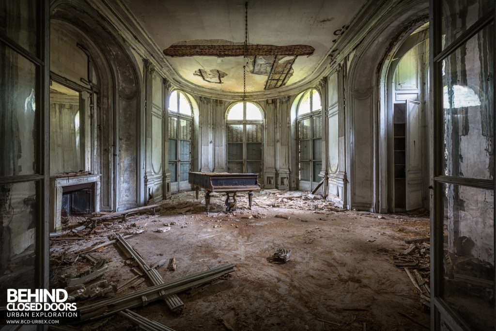 Château Bambi, France - Grand piano in a decaying room