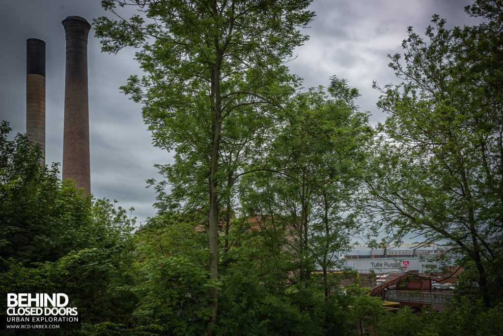 Tullis Russell Papermakers - Power station chimneys and the main building through the trees