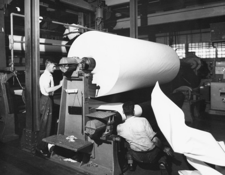 Archive image of workers with a huge roll of paper at Tullis Russell