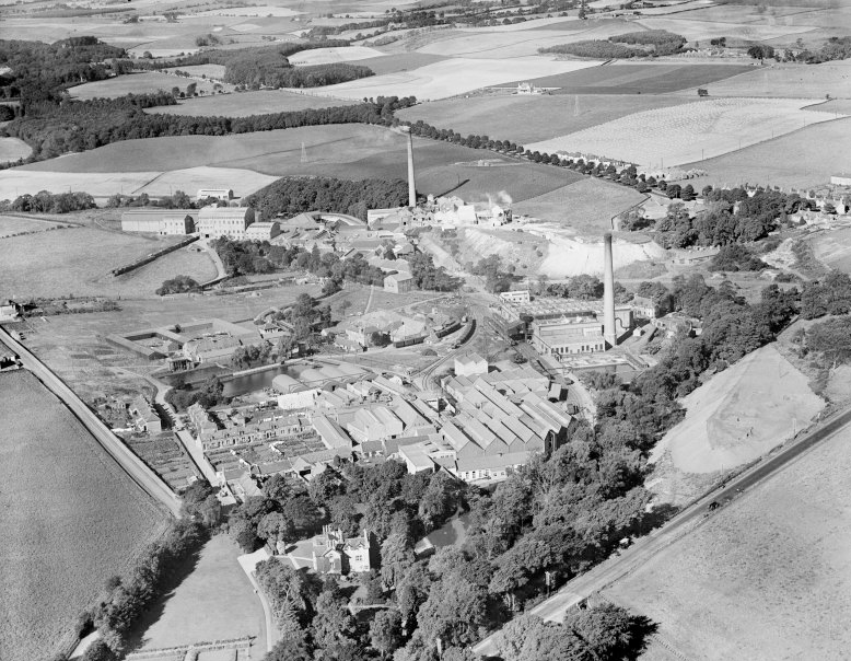 Aerial view of the site in 1931 with Auchmuty mill towards the top, Rothes mill bottom left and the powerhouse on the right​