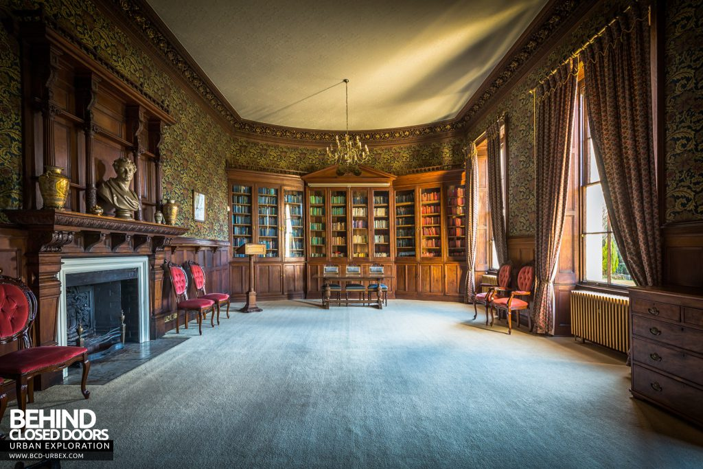 Quorn House - Grand library with elegant fireplace