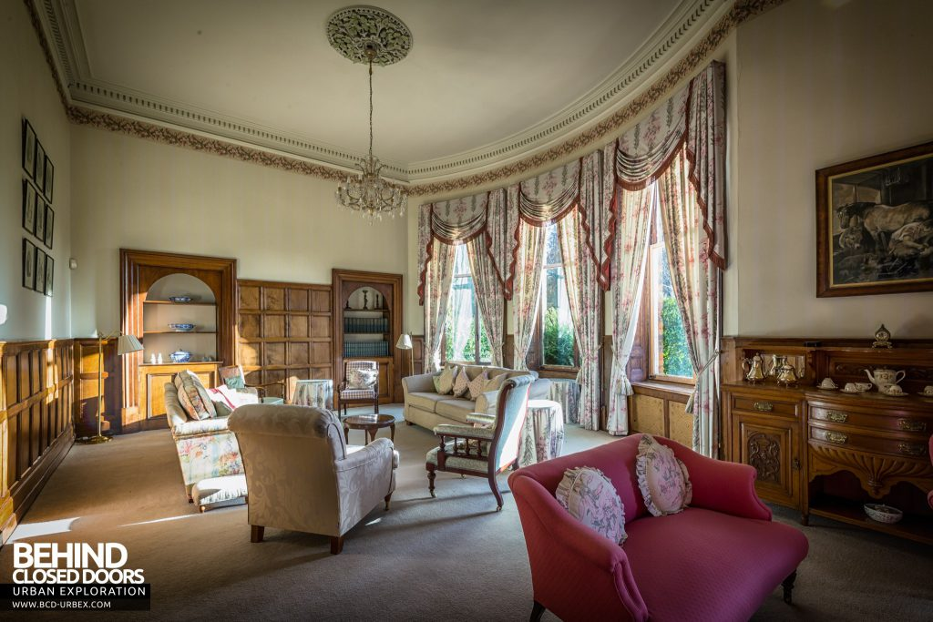 Quorn House - Sitting-room with grand curtains and furniture