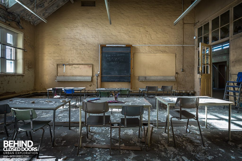 St John the Baptist School, Wigan - Class with chairs and tables facing blackboard