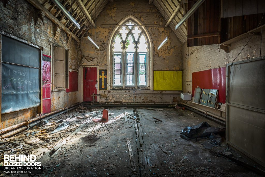 St John the Baptist School, Wigan - Chapel classroom with arched window and cross on the wall