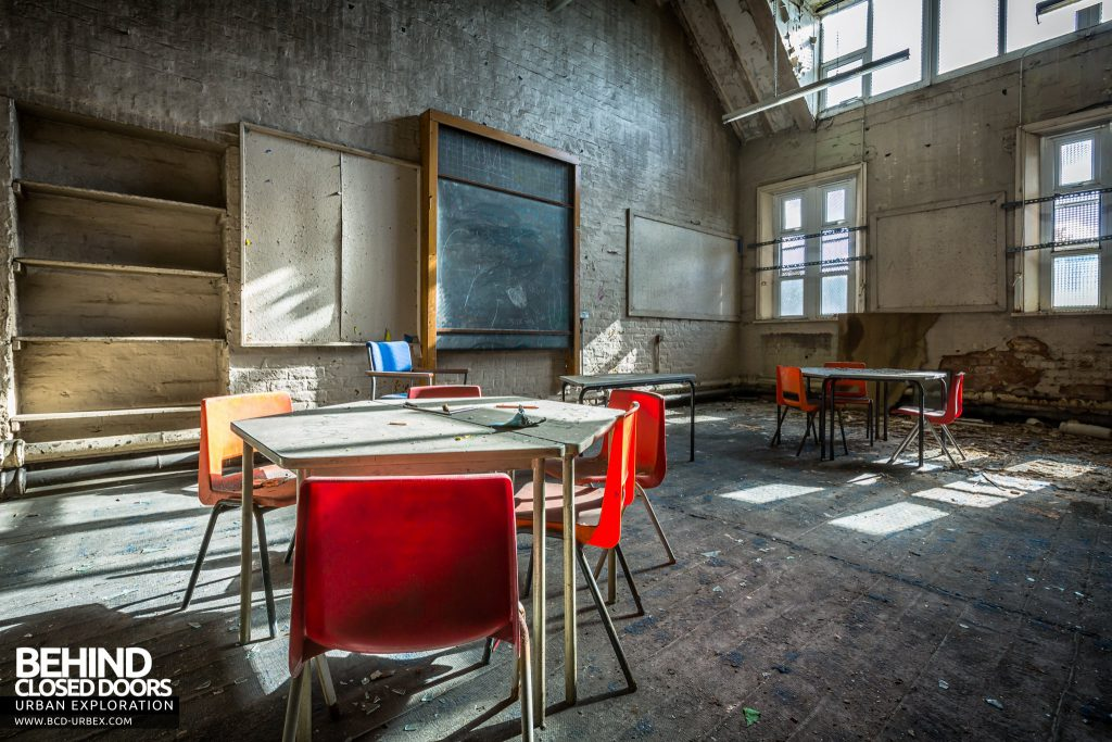 St John the Baptist School, Wigan - Classroom for infants with chairs and hexagonal desk