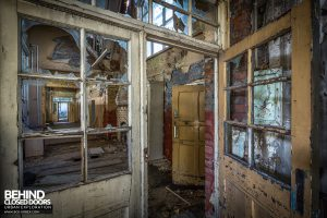 St John School - Corridor through broken windows