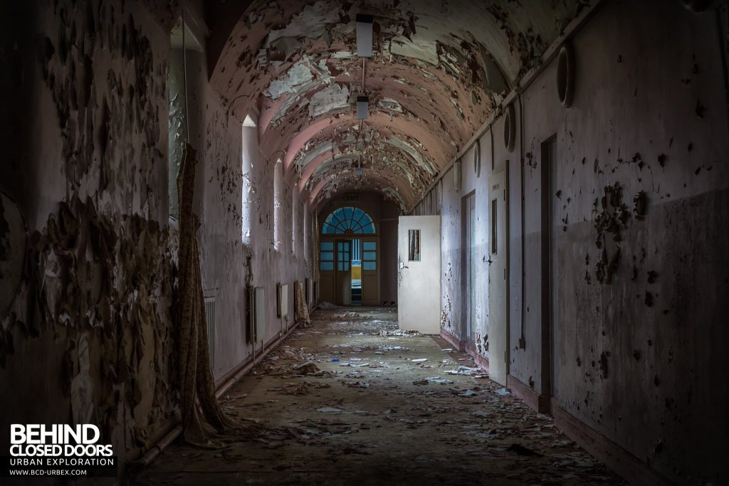 St. Brigids / Connacht Asylum - Light illuminates a single open door in decayed corridor