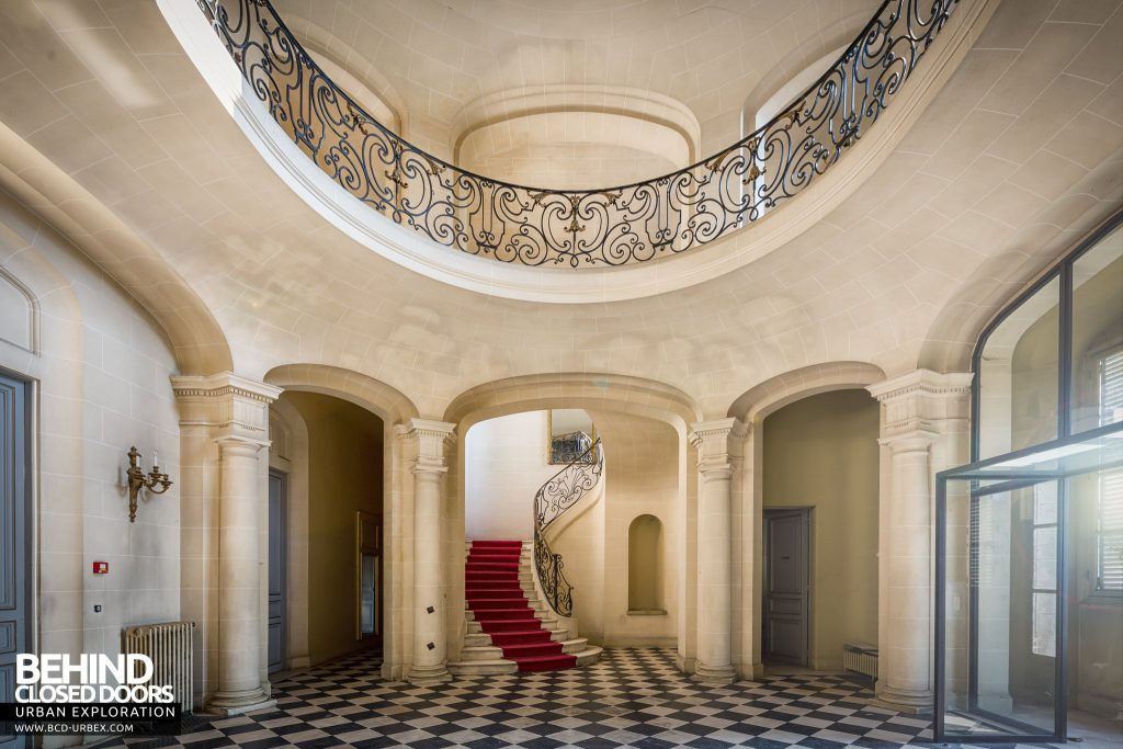 Château Sarco, France - Arches to staircase with red carpet