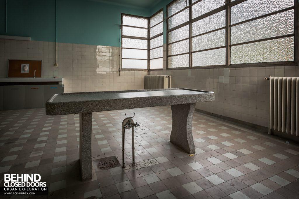 La Morgue Prelude, France - Morgue slab with taps underneath