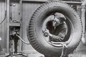Goodyear Mixing and Retread Plant, Wolverhampton - Archive image of an employee working on a tyre