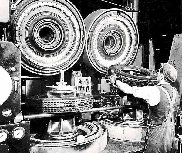 Goodyear Mixing and Retread Plant, Wolverhampton - Archive image of a worker fitting tyres to machinery
