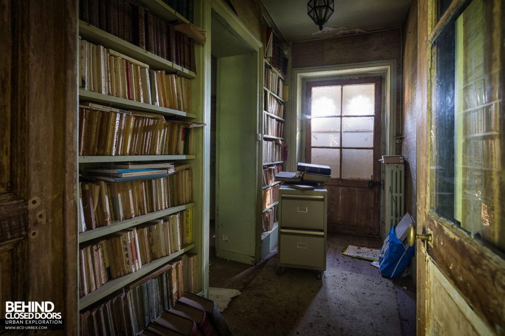 Abandoned French Chateau - Books in hallway