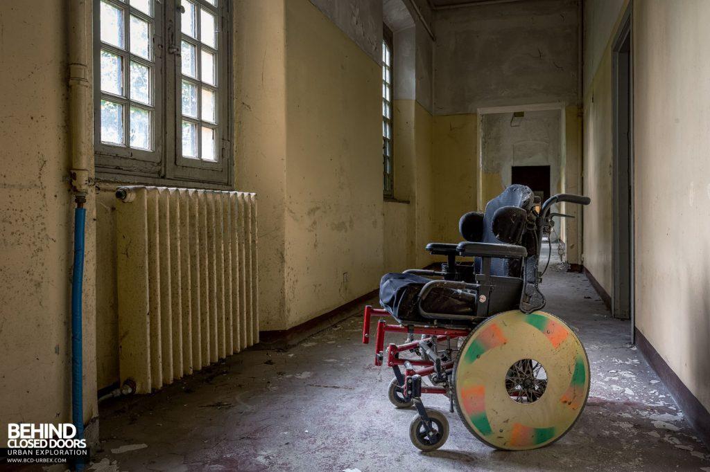 Manicomio Di Voghera - A wheelchair in a corridor