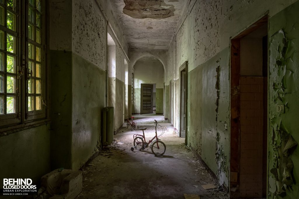 Manicomio Di Voghera - One of the darker corridors contains a child's bike