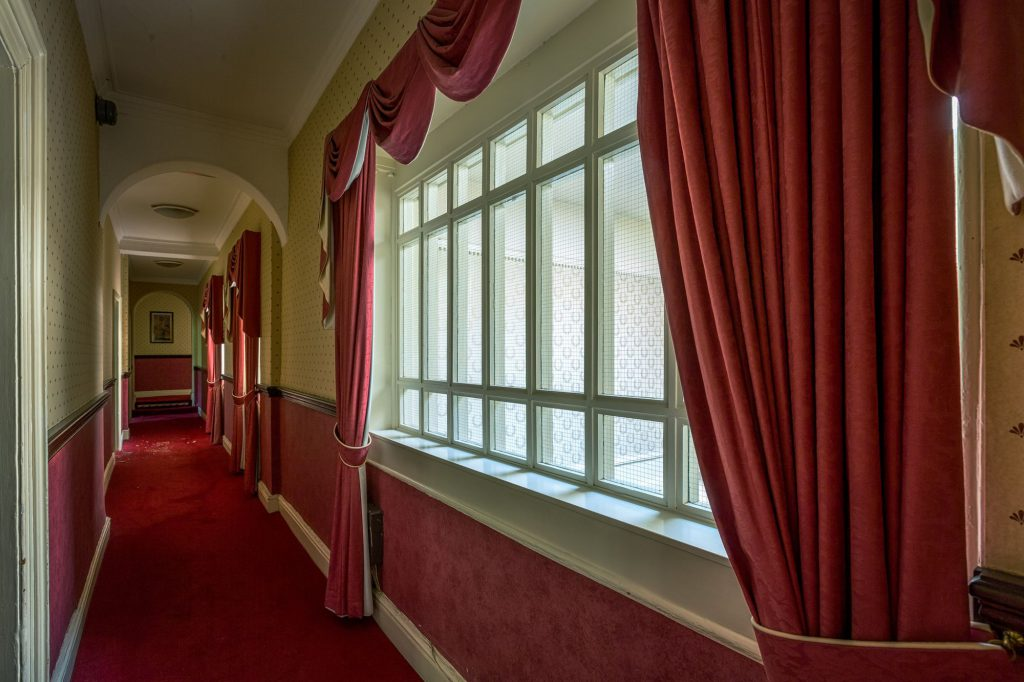 Royal Hotel - Curtains in a corridor