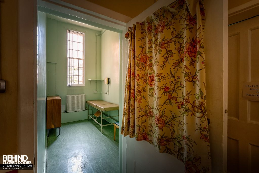 Whitchurch Hospital - Dated curtain hiding an examination bed