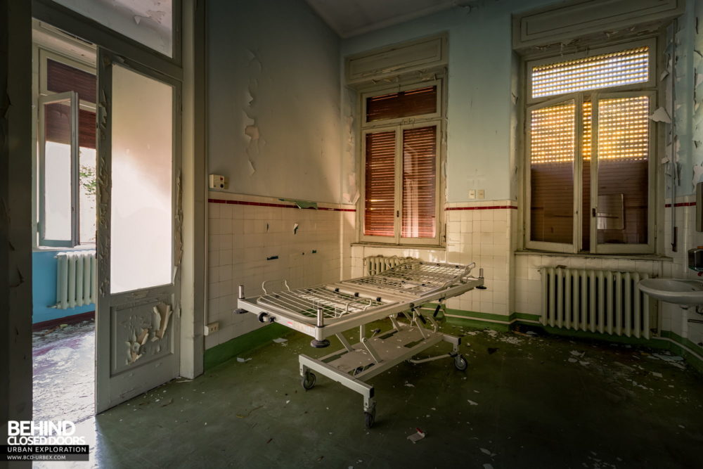 Tuberculosis Sanatorium / Hospital, Italy - Room with a bed frame