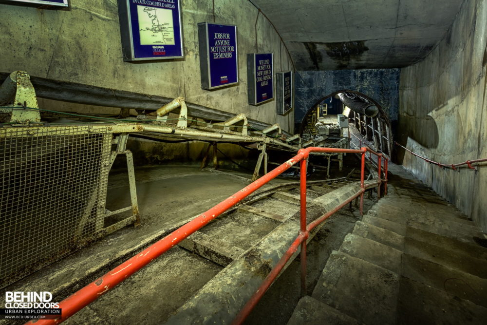 Chatterley Whitfield Underground Experience - View down the conveyor, with posters promoting jobs in the coal industry