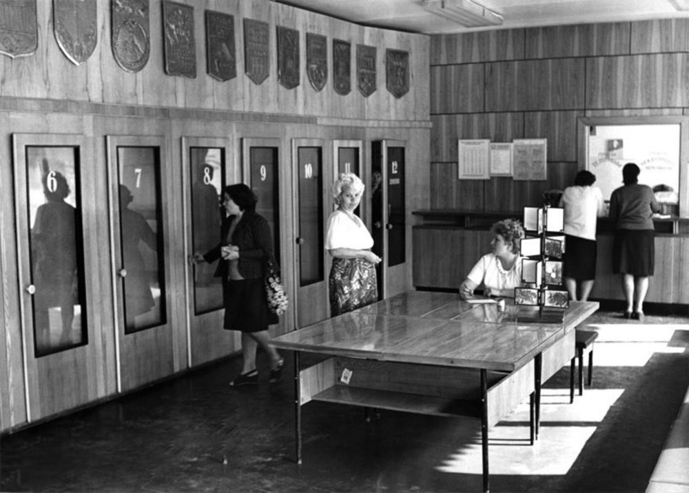 A room containing numerous telephone booth when the post office was open