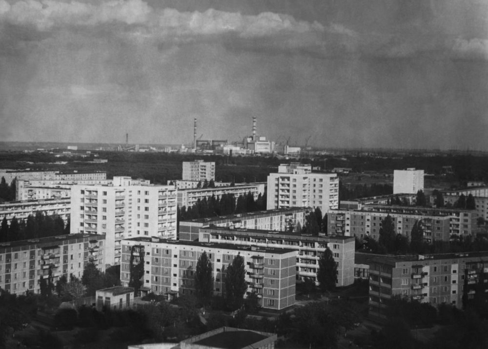 View over the rooftops of Pripyat towards the Chernobyl Power Plant